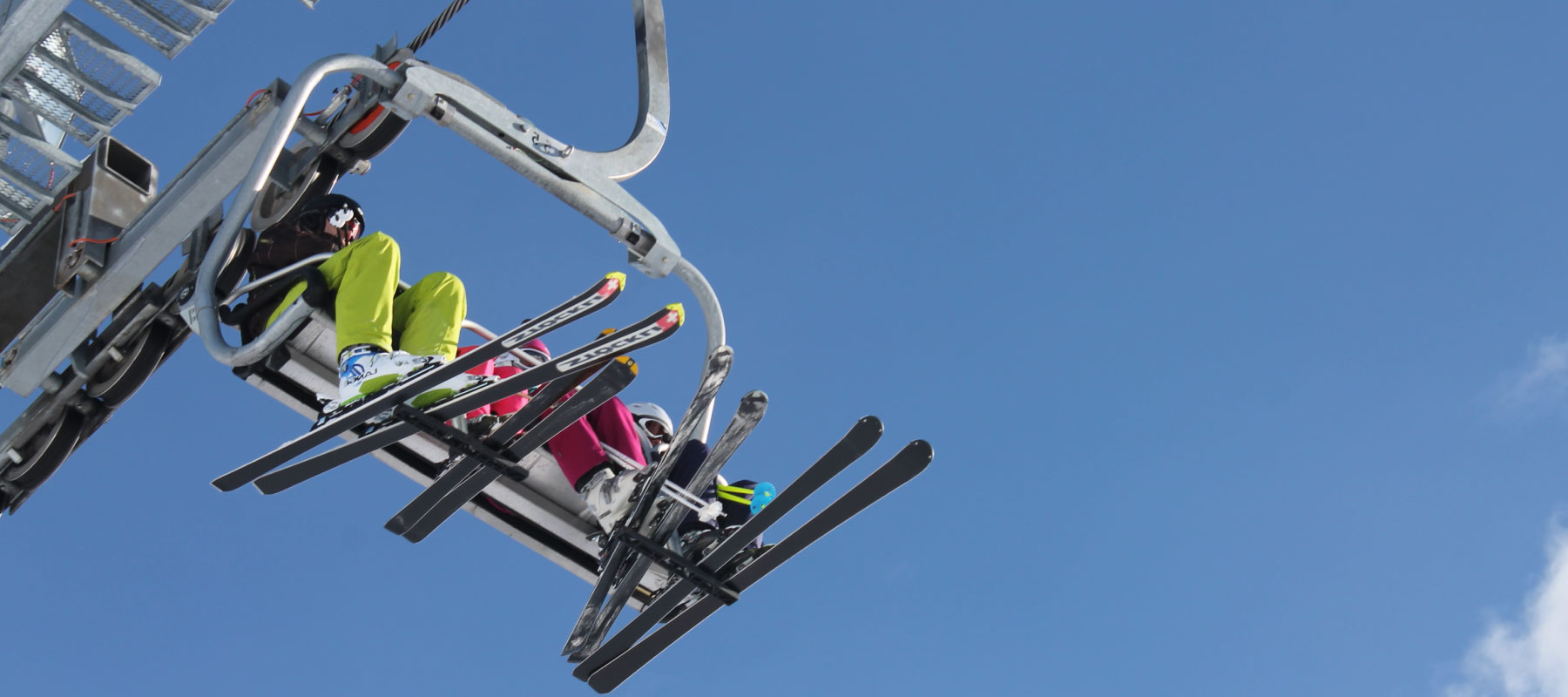 skiers on a lift