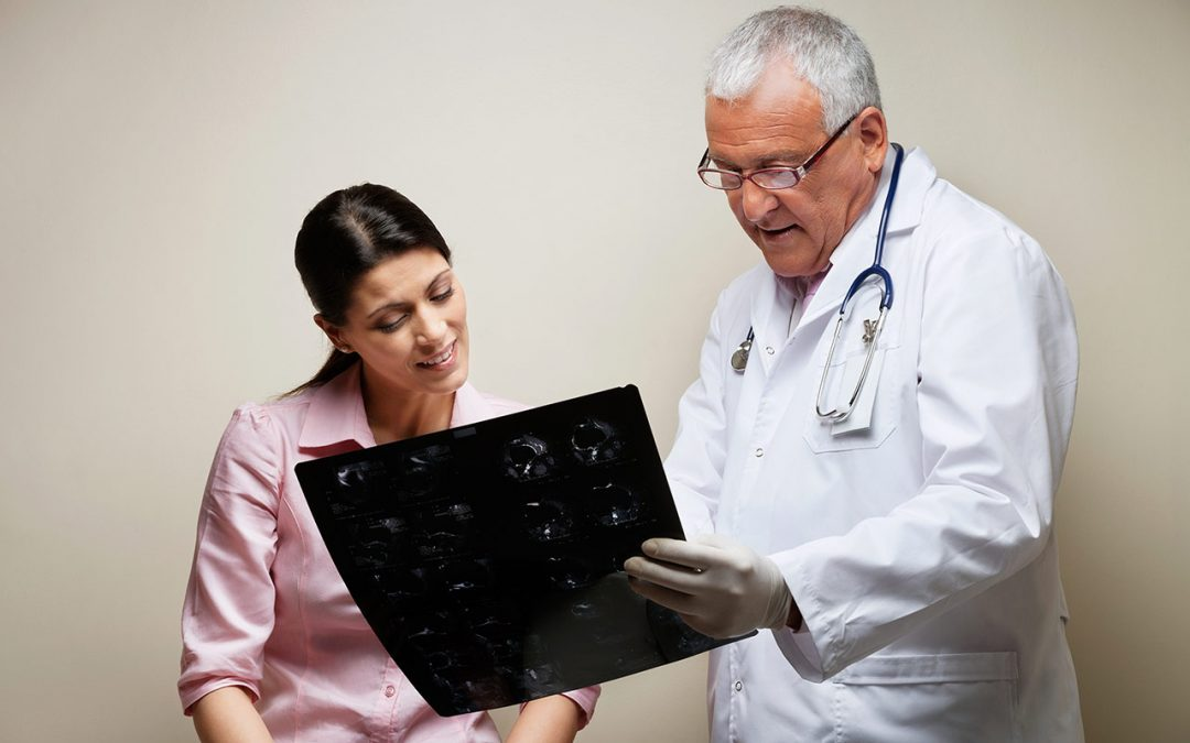 doctor reading x-ray to patient